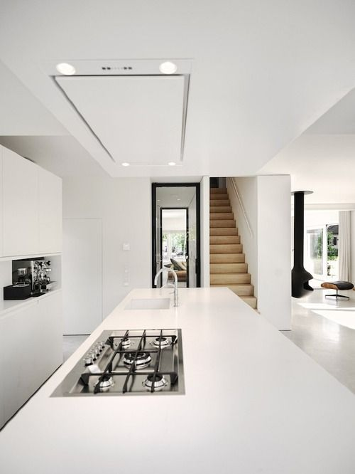 Clean and crisp, design places cooker & sink in the island for entertaining...
