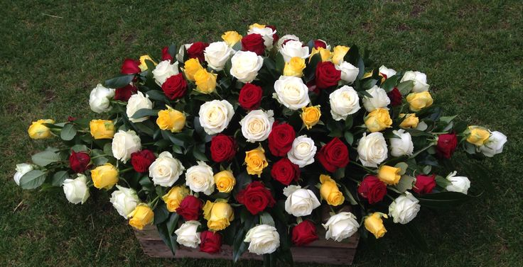 Red yellow and white rose spray