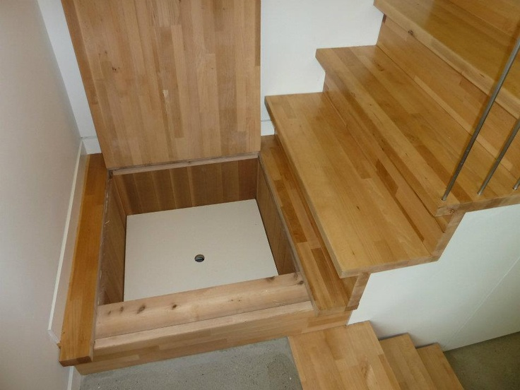 Stair landing storage by lanefab design build space for Wood floor 90 degree turn