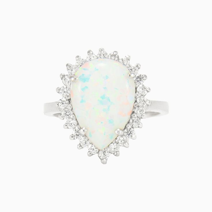 A beautiful, classic ring in sterling silver with cabochon pear shaped Opal surrounded by crystals.