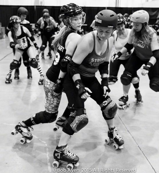 "When we learn to skate in roller derby, we are often told ""get low,"" which leads to the idea that we have to spread our legs wide, hunch our bodies over and stick out our butts. While this does create…"
