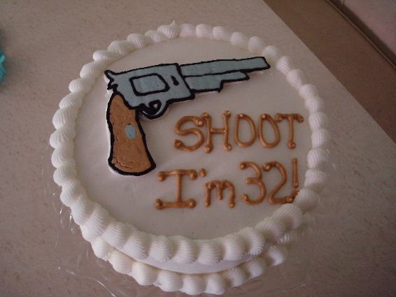Hand gun birthday cake. My number's a little higher.... eeek!