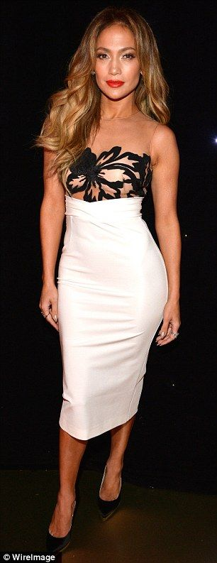 Jennifer Lopez in a skin-tight white skirt with a sheer bodice decorated with black flowers by Zuhair Murad