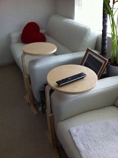 A brilliant way to hack a $15 IKEA stool into a sofa/laptop stand.