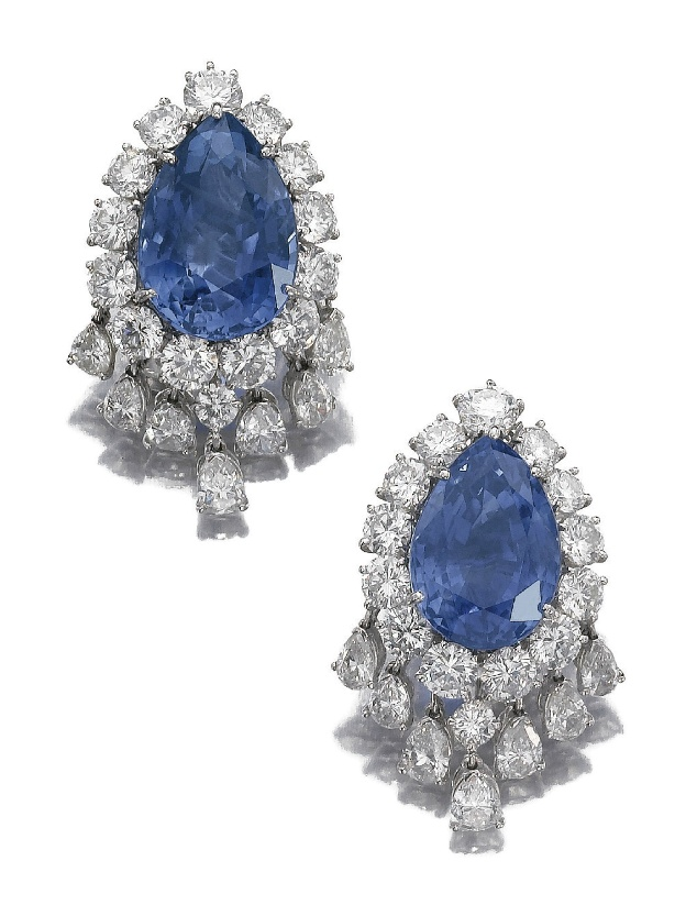Pair of sapphire and diamond ear clips, Van Cleef & Arpels.  Each centering on a pear shaped sapphire framed with brilliant cut diamonds, suspending a fringe of pear shaped stones, signed Van Cleef & Arpels