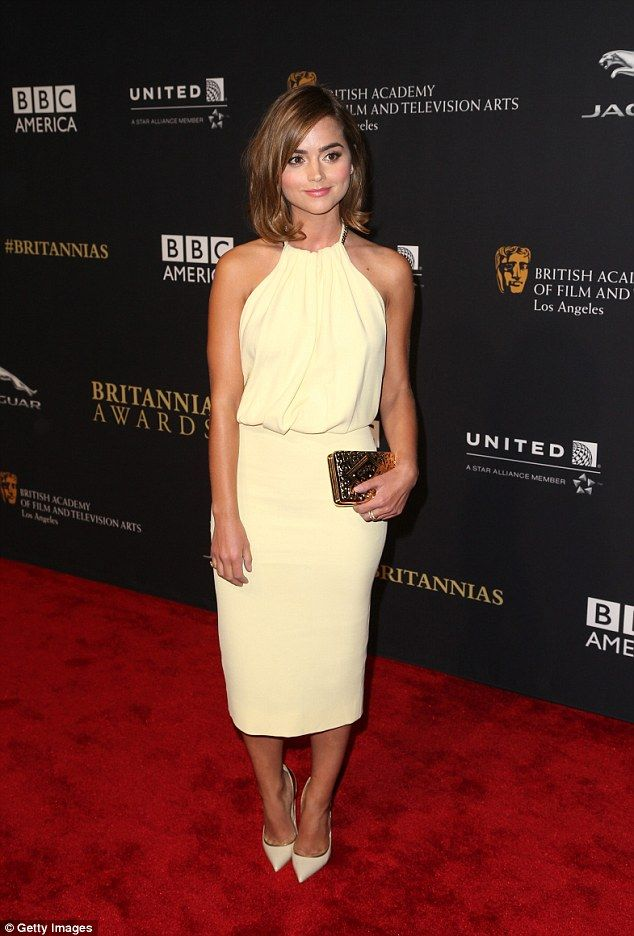 In the bag: The Doctor Who beauty added a simple touch of glamour to her ensemble with a gold box clutch