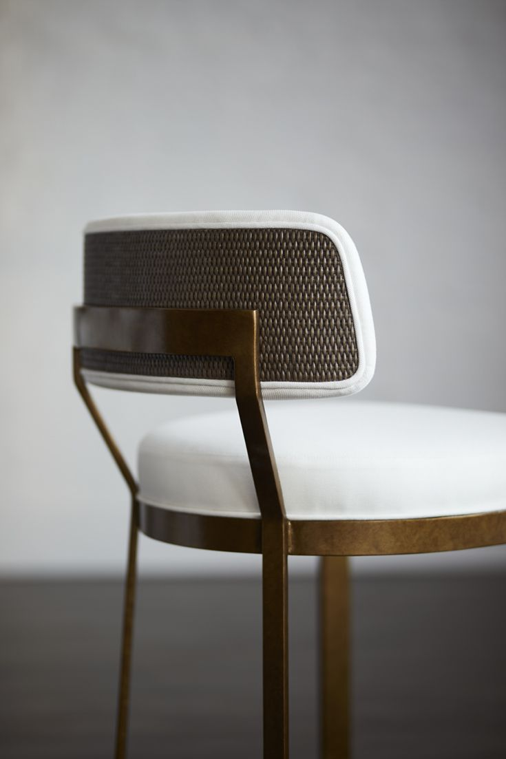 PALECEK CONRAD SIDE CHAIR GOLD Metal frame and legs in antique gold finish with fixed upholstered seat and inside backrest. The outside backrest features cane matting available in all PALECEK finishes. Coordinates with the Conrad antique gold collection.