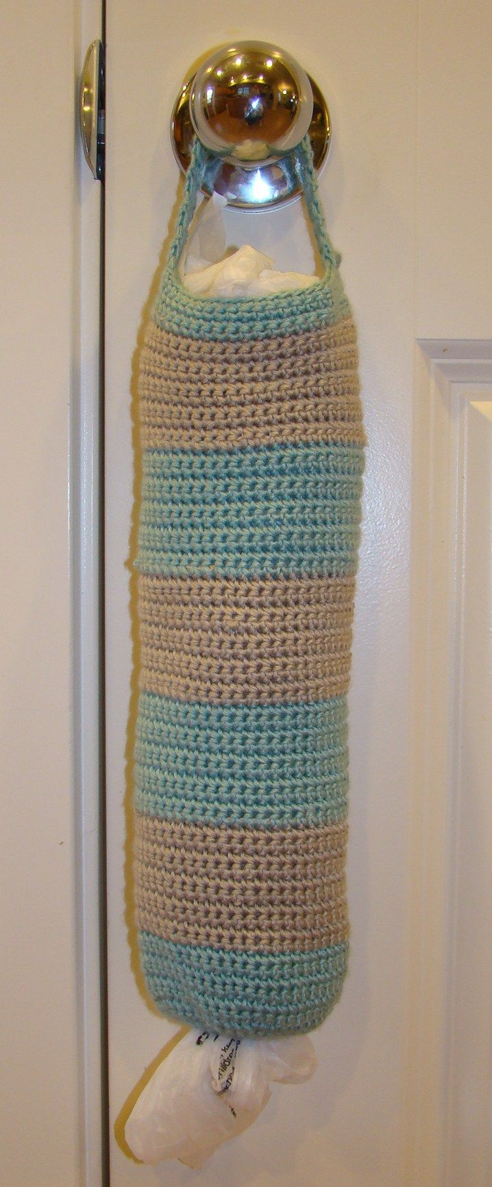 Easy, Cute, and Useful! This Grocery bag holder can be as long as you need. It is made from Spa Yarn (size 3) but will work with any yarn or colors you want.  Great idea for those who hold on to their grocery bags.