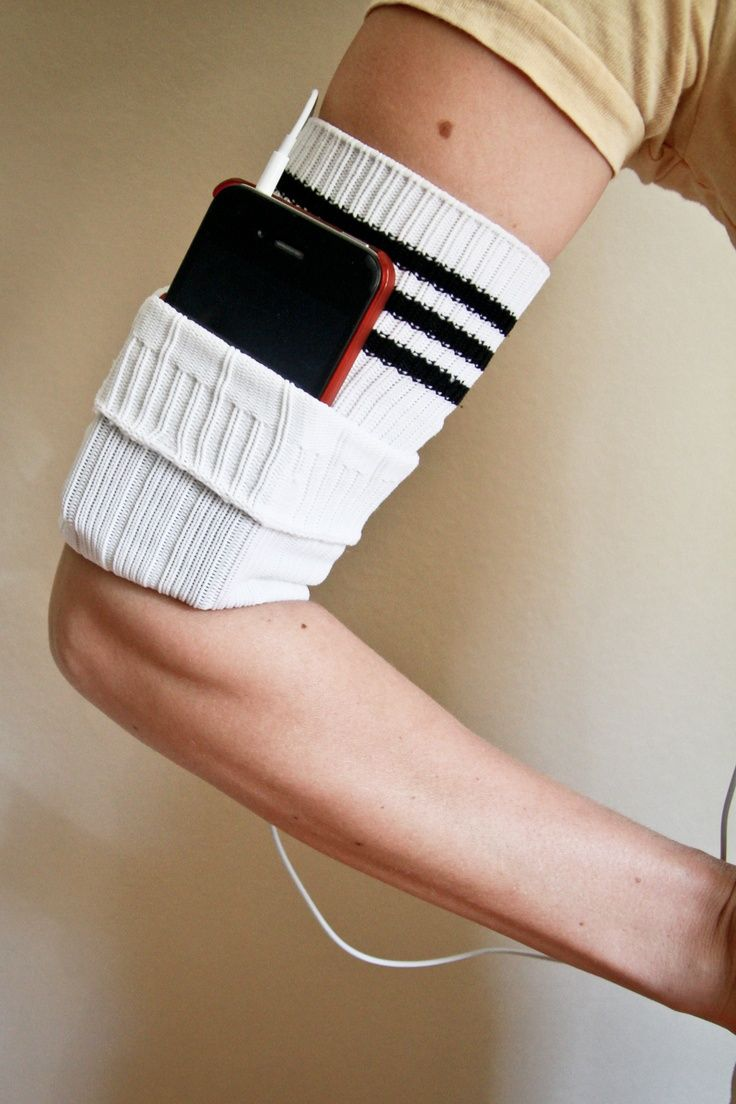 Reusing old Socks | ecogreenlove Turn an old sock (the non-foot part) into a phone/mp3 player armband.  (I so need this!)