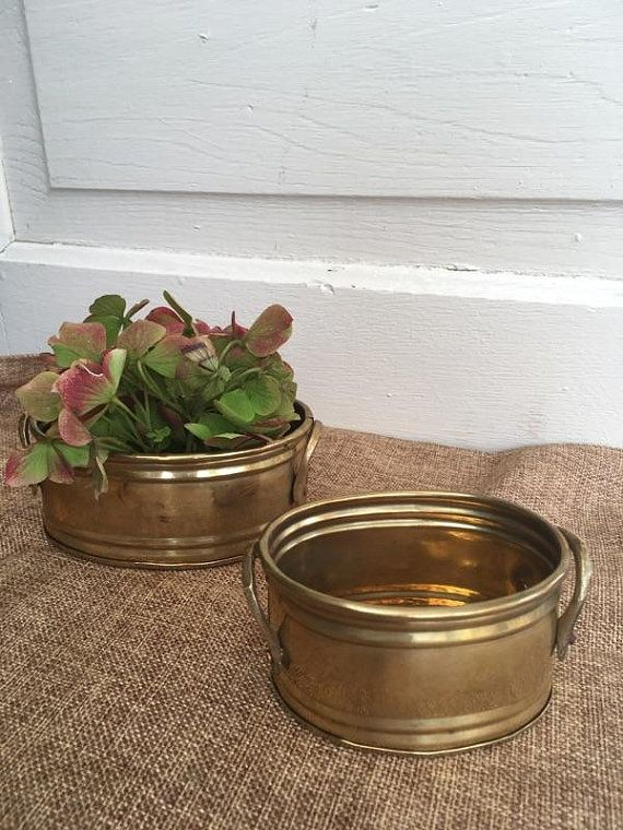 These pretty little brass tubs are so versatile!  Use them as planters around your home, as business card holders in the office, to hold tea bags or toothpicks in the kitchen, a catch all tub for keys, change etc. The possibilities are endless!  Set is in good, vintage condition.  Large measures approx. 5 x 3.5 x 2. Small measures 4 x 3 x 2  Made in India