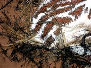 Emu feathers for an emu chick!  This is a close up of my textile art piece of a baby emu sitting on the nest.  #textileart www.lyndaanne.com