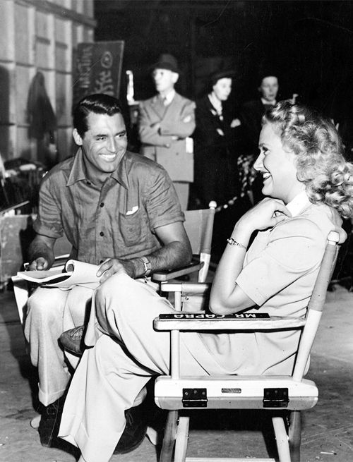 """Cary Grant and Priscilla Lane on the set of """"Arsenic and Old Lace"""", 1944"""