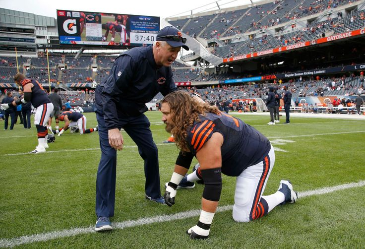 Chicago Bears head coach John Fox talks to Chicago Bears offensive tackle Nick Becton (71) before an NFL football game against the Detroit Lions, Sunday, Oct. 2, 2016, in Chicago. (Credit: AP / Nam Y. Huh)