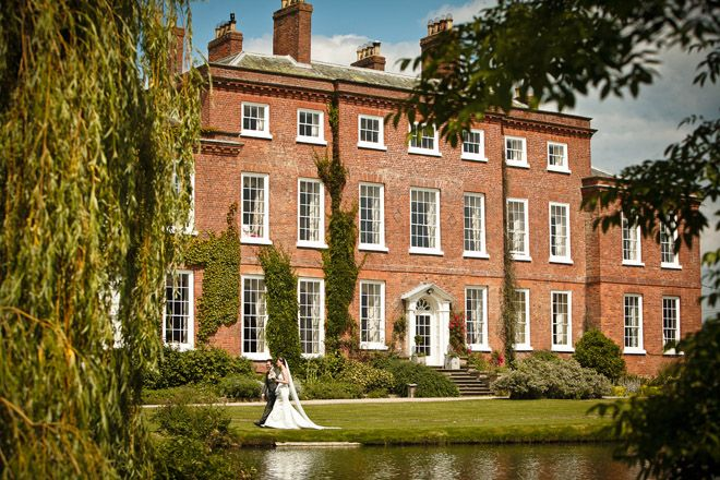 Five West Midlands Wedding venues - Delbury Hall, Shropshire. Imagine being lord or lady of a country manor for the day and you'll picture yourself standing before a magnificent country house like Delbury Hall. This lakeside Georgian mansion has all the good looks of a mansion with the warm, friendly atmosphere of a family home.