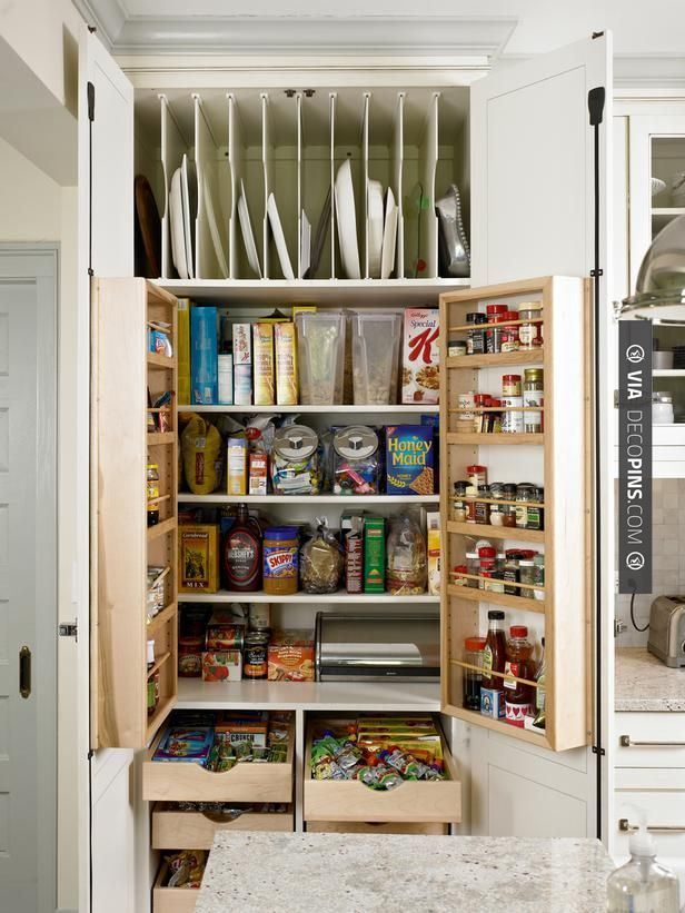 Like this! - The floor-to-ceiling, 40-inch-wide pantry outfitted with shelves and drawers is large enough to store all those bulk-purchased goods. Bonus: The pantry is right next to the island, where the kids sit for afternoon snacks, so it helps them help themselves. The refrigerator-style hinges all around the kitchen … More | CHECK OUT MORE KITCHEN CABINET IDEAS AT DECOPINS.COM | #kitchencabinets #kitchen #cabinet #kitchencabinet #kitchencabinets #kitchenstorage #pantry