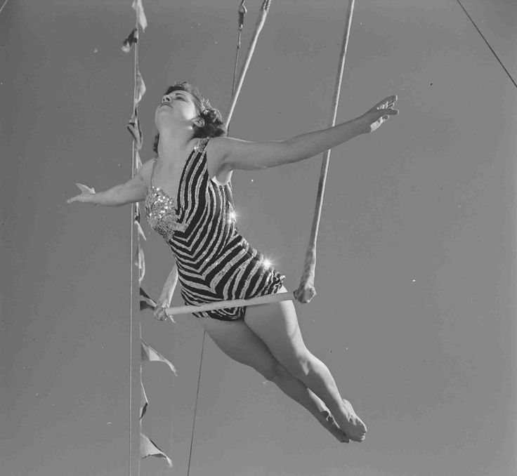 A trapeze artist photographed by Loomis Dean, 1952.
