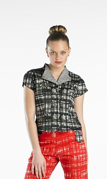Part of the series of Terrier Tops comes the Fox Terrier Shirt in an alert black & white chisel-like tartan of cotton/spandex. Featuring front bottom opening, standup back collar, fitted front, short sleeves and comes just under the waist. Just like the Fox Terrier a fearless shirt for either the boardroom or leisure...