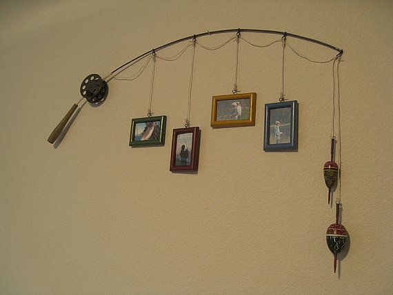 Fishing pole frame holder- might be cute for a fisherman themed bedroom