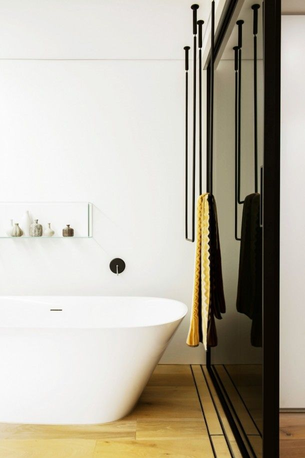 Bathroom - Awesome Combination Of Black Towel Hanger Beside The White Tub In Clean Simple Lines Bathroom With Wooden Floor: An Award Winning Simple and Minimalist Bathroom Design Ideas