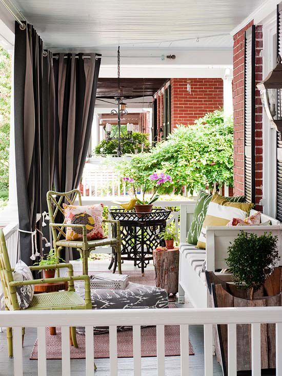 Porch Retreat from Better Homes and Gardens. I could add curtains like this to my front porch! Use the hardware for a shower curtain or closet, to hang these,and you could even use some shower curtains as they resist mildew and mold better than regular fabric. Gives a sense of privacy and intimacy to late night cocktails with friends and keeps out the bugs!! Provides nice shade too.