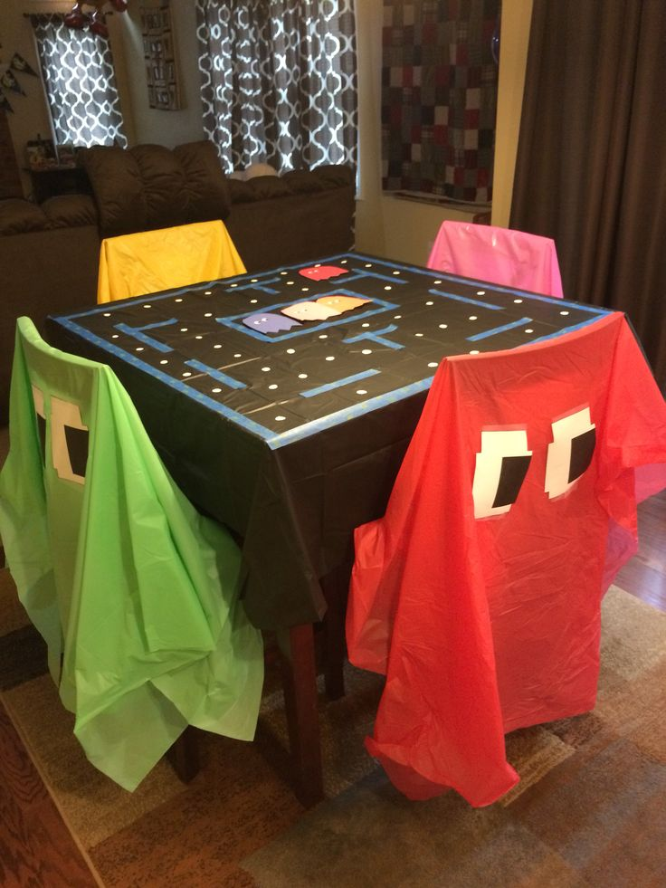 5 table cloths with printed eyes and blue painters tape pac man party