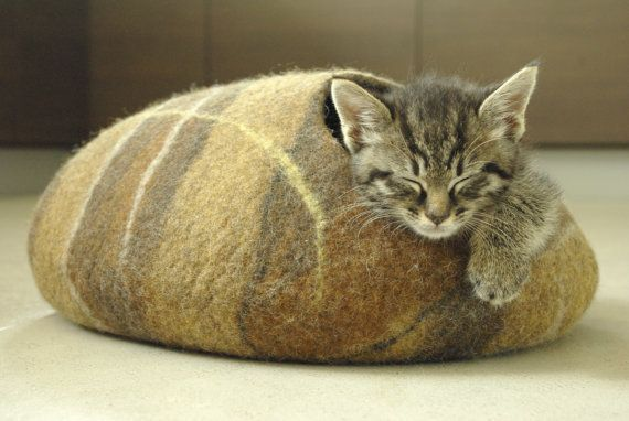 We rarely use the word adorable, but this pretty much defines adorable. Lithuanian artisan Klaidas Akelis crafts felt cat caves from 100% merino wool. They come in a range of colors and sizes. $67 for the cave pictured here; others can be seen in the Elevele Etsy shop