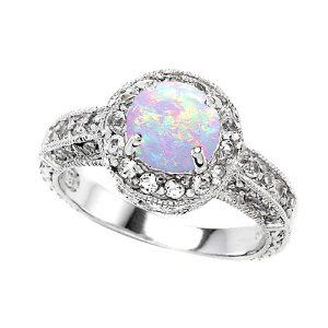 Opal Engagement Rings <3 I don't want a diamond I would rather have a beautiful white opal. No two Opals are the same and you could spend forever finding new colours and and spectrums in a good quality opal.