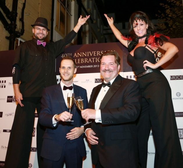 Wizardry stilt walkers, Beckie and Anthony with Belle Epoque director, Richard Walker and proprietor, Matthew Mooney