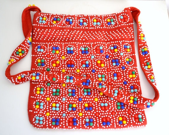 Betcha did.  1970s beaded bag, little half moon shaped beads.