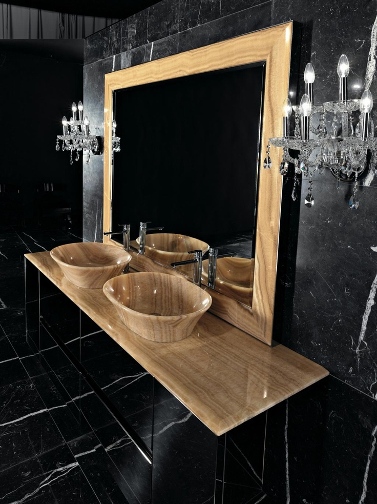 FOUR SEASONS 05 - Vanity cabinet of polished steel. Top of Streaked Onyx. Washbasin of Streaked Onyx mod. Oval 62. Mirror with frame of Streaked Onyx. Wall lamps 5 lights of transparent Bohemia crystal.