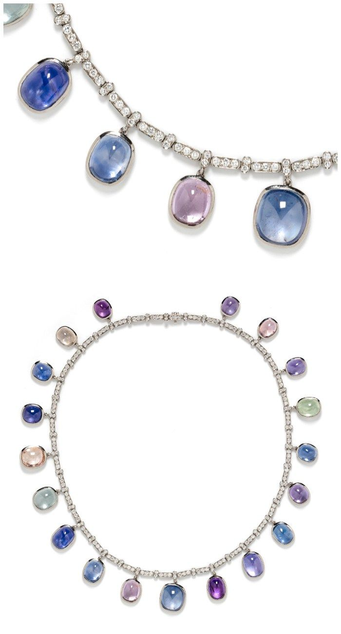 A wonderful necklace with diamonds and pretty, variously colored cabochon sapphi...