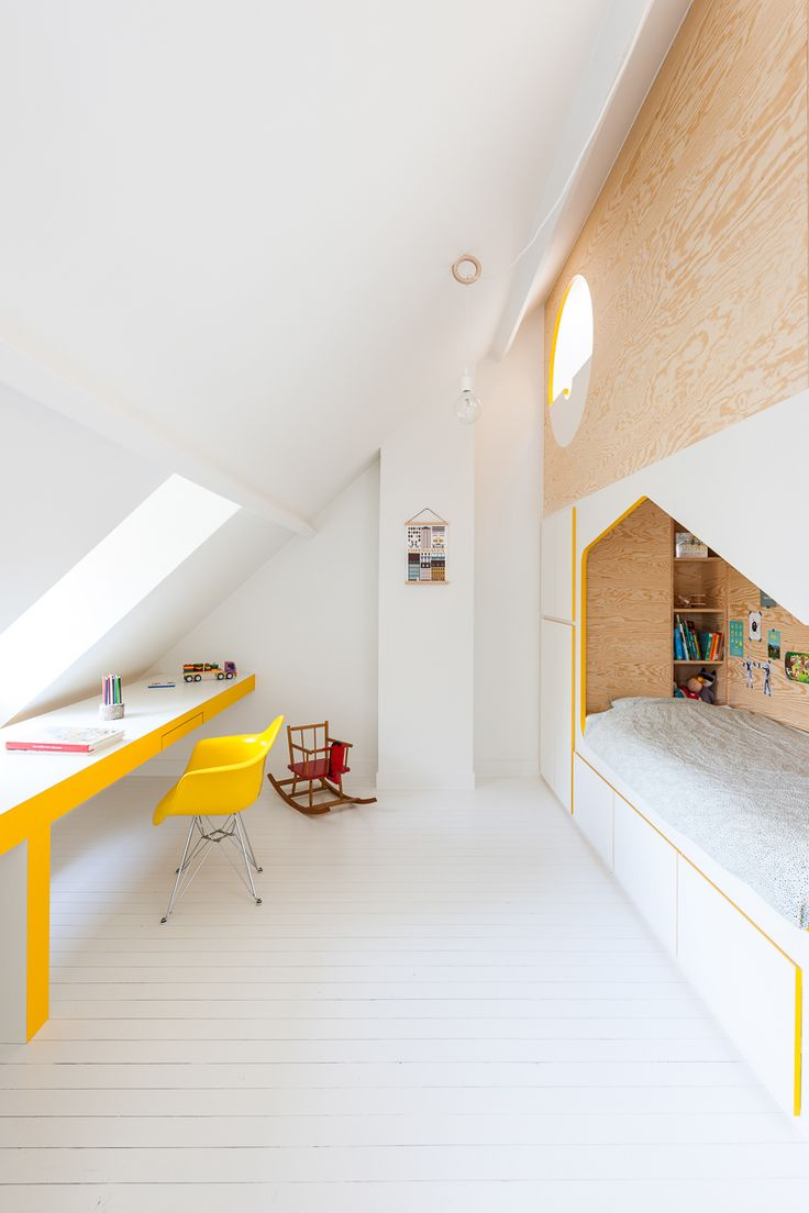 Brillant Minimalist Kid`s Room.White floor, yellow chair and built-in bed