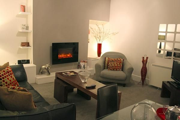 Relax and put your feet up in front of the fire at Suite 10 Fossgate, available to rent. www.iknow-yorkshire.co.uk