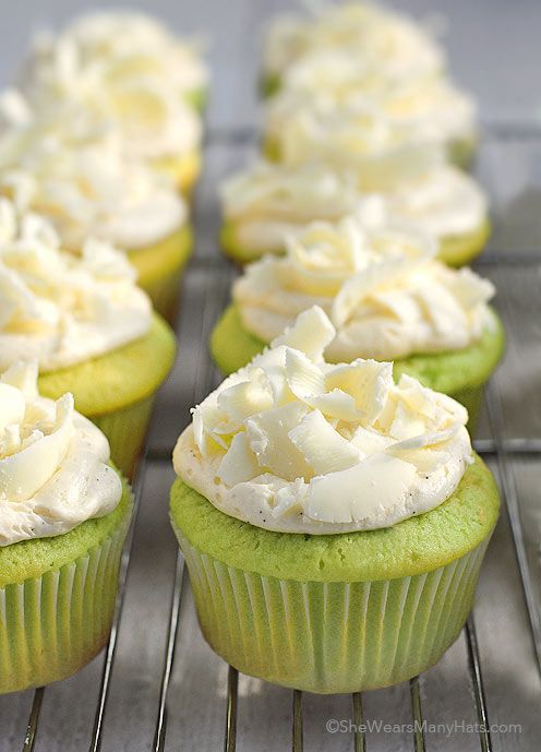 Easy Pistachio Cupcakes Recipe topped with white chocolate shavings. So fun for holidays and parties!
