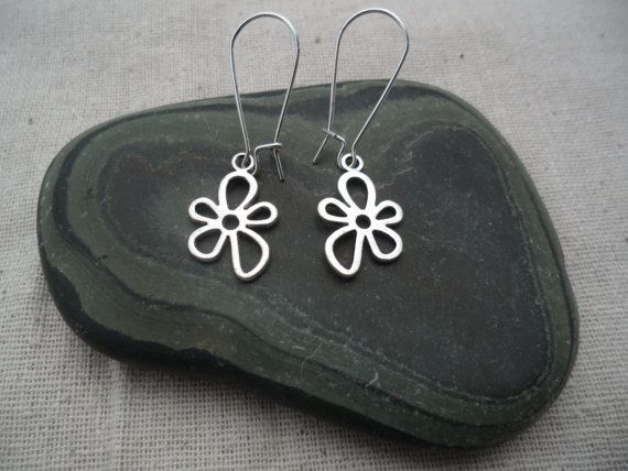 These are so unique and whimsical! Silver Flower Earrings are lightweight and hang from allergy free silver plated kidney style earwires. The