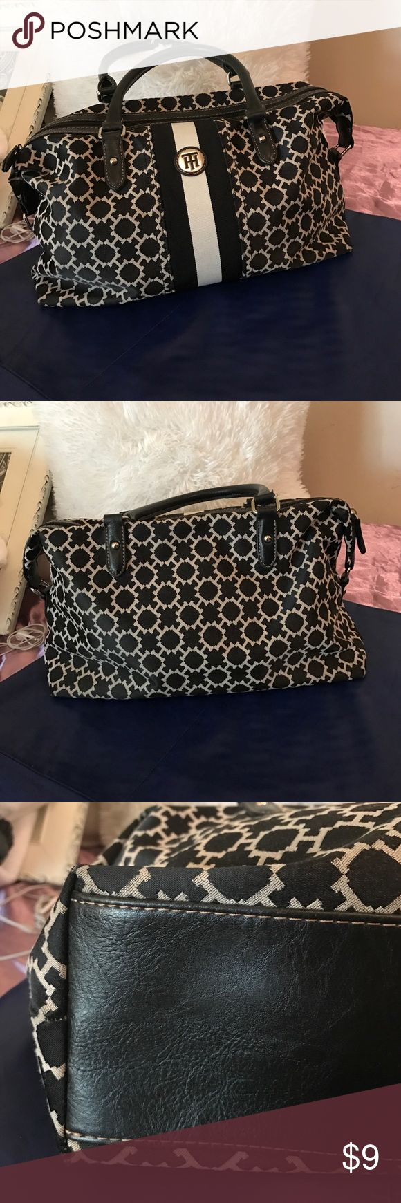 Tommy Hilfiger Handbag Tommy Hilfiger bag black and white. You will find a slit on all the handles of the bag see pictures. This bag has been discounted based on the defect. Tommy Hilfiger Bags Totes