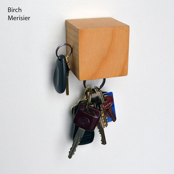 Cube shape magnetic wall mounted keys keeper (on four sides). Made with real walnut, mahogany or birch veneer. Theres a key hold in the back to hang it to the wall. Color and pattern may vary slightly from images. Dimensions: 2.25 x 2.25 x 2.25 (6cm x 6cm x 6cm). The bottom side can hold
