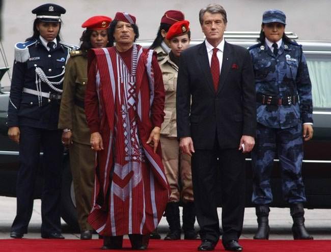 Former Libyan leader Muammar Gaddafi (left) with his all female bodyguards walking with former Ukrainian President Viktor Yushchenko in Kiev in 2008.