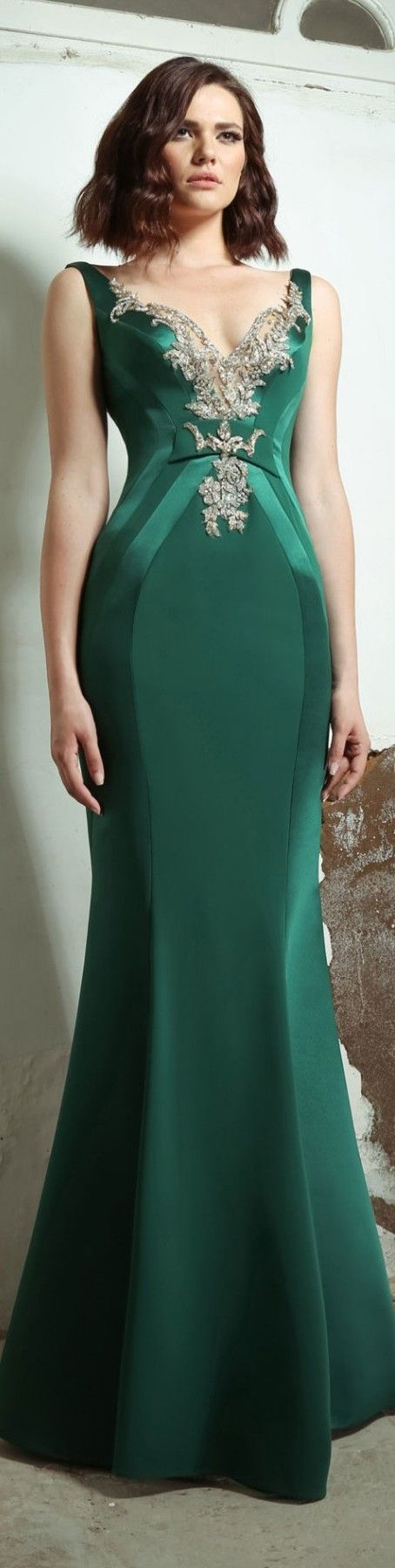 Green sleeveless evening dresses with v neck lines. Encrusted bead work on the upper bust line to accentuate that area. Slimming lines and figure conscience shapes on this evening gown make it a winner. Get more formal dress inspiration at www.dariuscordell.com