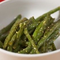 Green beans cooked in lemon and garlic in a white bowl