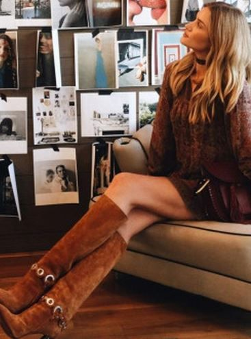 Who made  Rosie Huntington-Whiteley's red tassle handbag, brown suede boots, and print dress