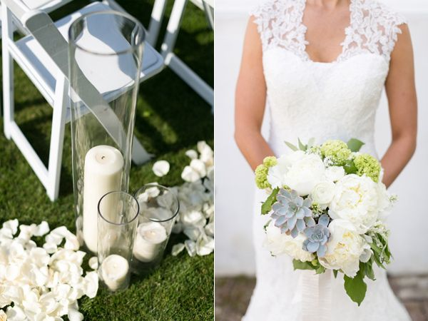 Love the isle decorations: flower pedals & varying size candle holders ... would be cute for a beach wedding, too!