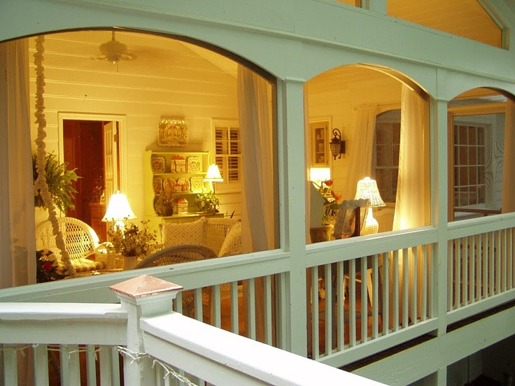 Screened porch with lamplight in evening