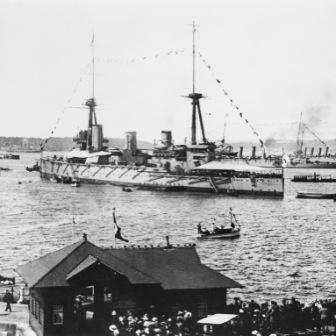 HMAS Australia (I) leads the first RAN fleet into Sydney Harbour on 4 October 1913
