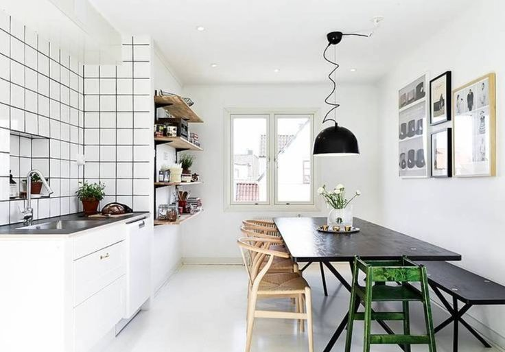 White Scandinavian Kitchen Design With Black Table, Pendant, Bench And Wooden Chairs