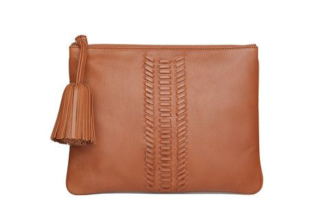 Editors Pouch Whipstitch in cognac.  Thoughtfully designed for all your needs, this minimalist flat bag features a clean  look and whipstitch detailing. Sling it crossbody or tuck this versatile style under your  arm like a clutch.
