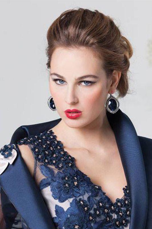 Abito da Cerimonia donna con corpetto in pizzo florealee giacca particolare con trasparenze.
