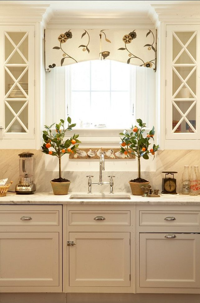 White Kitchen with Prep Sink. Carrera marble countertops and backsplash.
