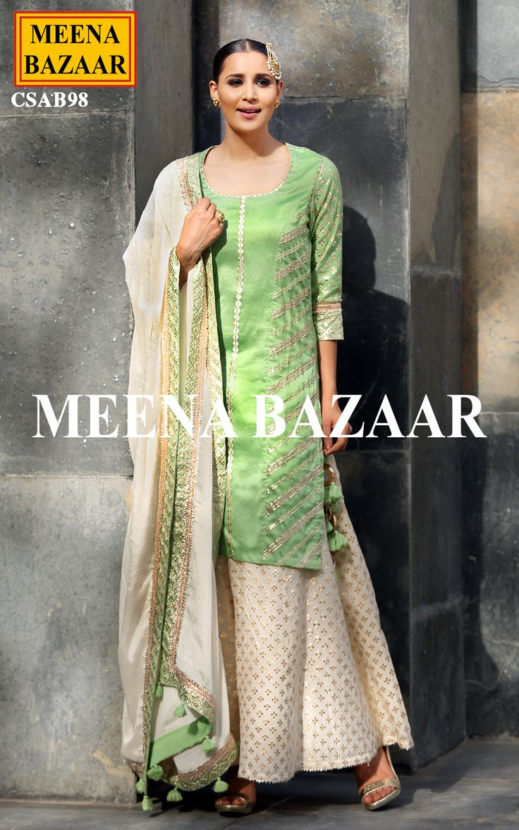 Emanate feminine allure with this Green chanderi sharara suit. Featuring gotta and zari work embellishment. Comes with contrast chinon dupatta and banarasi chanderi sharara.