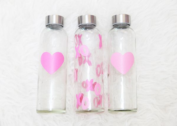 Hand-painted water bottles by Pottery Barn - get inspired to create your very own decorated water bottles, perfect for giving out as gifts or party favors! Check this (and other DIY project ideas) out on the #mygenue blog - https://mygenue.com/3-ways-spice-party-diy-style/ #partyplanning #partyfavors #diy #tutorial #graphicdesign #surfacedesign #genuinelyyou
